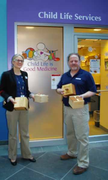 Stephen Parsons, Vice Chair AWA and Lisa Arsenault, Administrator IWK Child Life Services with samples of boxes